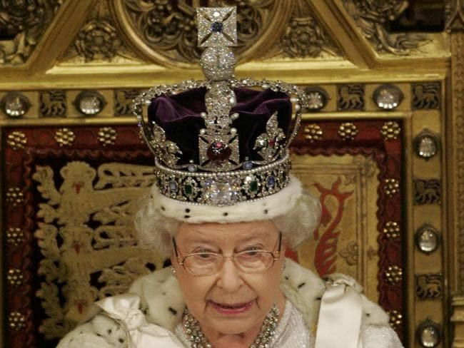 Queen Elizabeth II, wearing the Imperial State Crown, reads the Queen's Speech from the throne in the House of Lords, during the State Opening of Parliament in 2007.