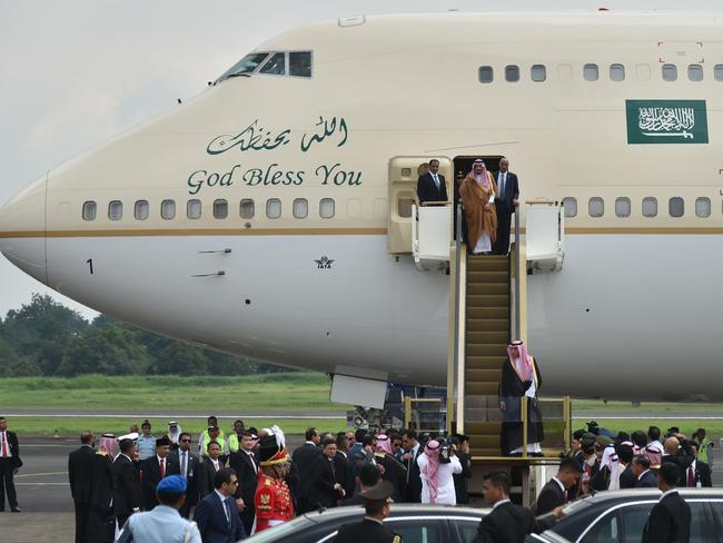 Saudi Arabia's King Salman bin Abdul Aziz exited his plane using a gold-coloured escalator. Picture: AFP/Bay Ismoyo
