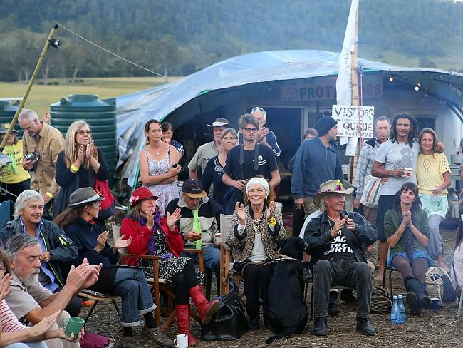 Protesters celebrate at the Bentley blockade site after a drilling permit allowing mining