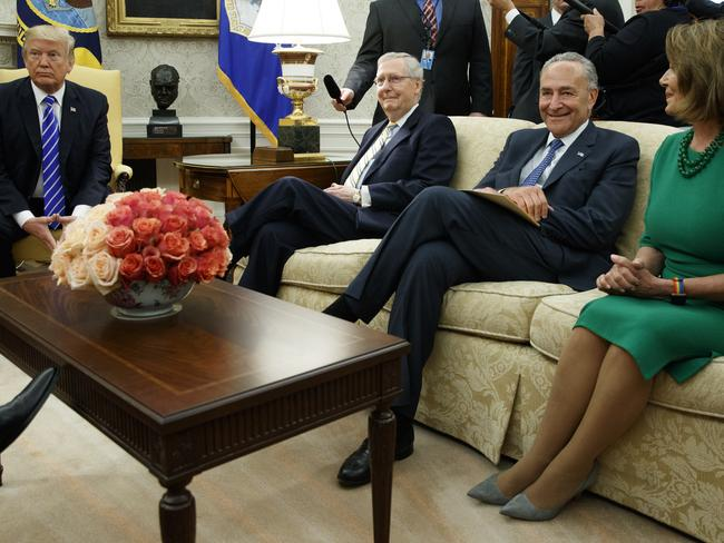 US President Donald Trump pauses during a meeting with, from left, Republican Senate Majority Leader Mitch McConnell, Democrat Senate Minority Leader Chuck Schumer, Democrat House Minority Leader Nancy Pelosi. Picture: AP