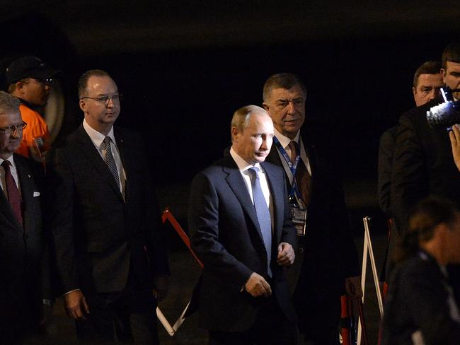 Stern faced on arrival ... Russian President Vladimir Putin arrives at Brisbane Airport ahead of the annual G20 Summit. Picture: Bradley Kanaris / Getty Images