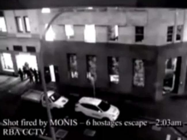 CCTV footage showing Man Haron Monis shooting at 6 Hostages as they escape the Lindt Cafe in Martin Place at 2:03am