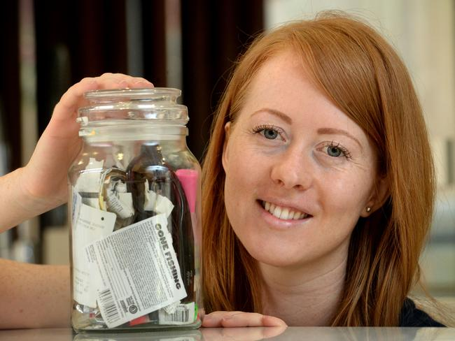 Erin Rhoads with a jar of all the rubbish she has generated in 18 months that can't be recycled. Picture: Kylie Else
