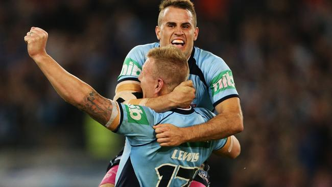 NSW's Josh Reynolds celebrates a NSW series win with teammate Luke Lewis.
