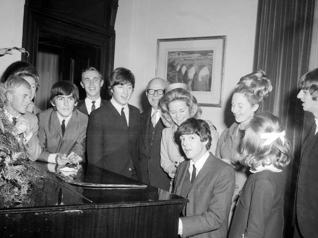 Loved by millions ... Paul McCartney playing the piano during The Beatles visit to Melbourne, at the Melbourne Town Hall during a State reception. Picture: Supplied