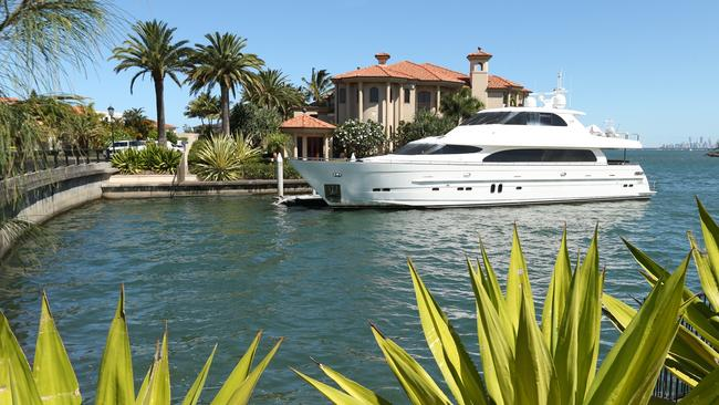 Clive Palmer's home on Sovereign Islands on the Gold Coast, with his multi-million dollar boat Maximus moored outside. Picture: Lyndon Mechielsen/The Australian