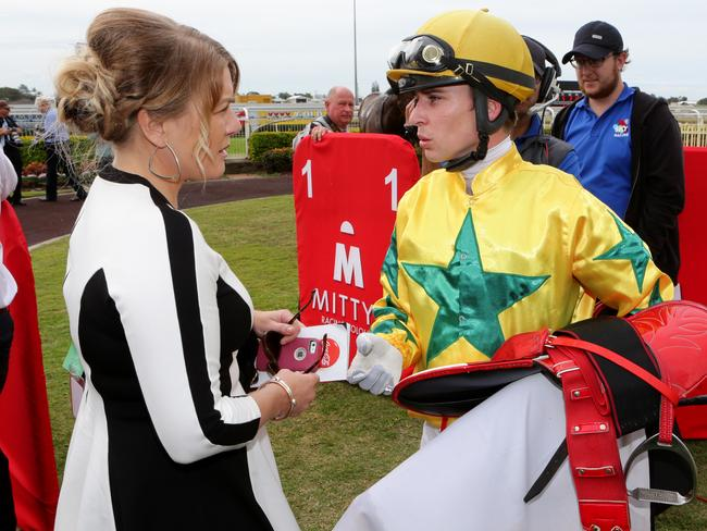 Mister Booze's trainer Kristie Clark-Peoples talks to jockey Tim Bell on his return to scale. Picture: Darren England.