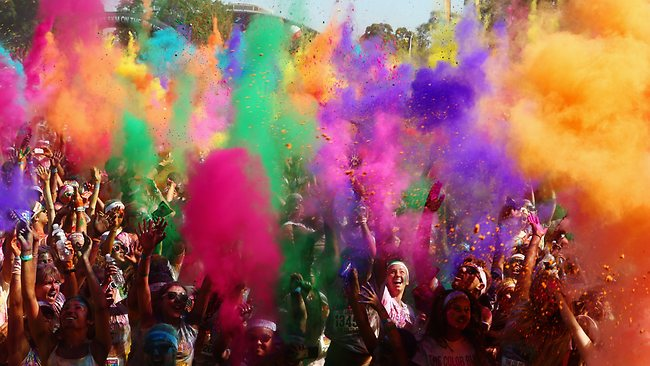 Finishers take part in a mass colour throw after completing the Colour Run. Picture: Getty