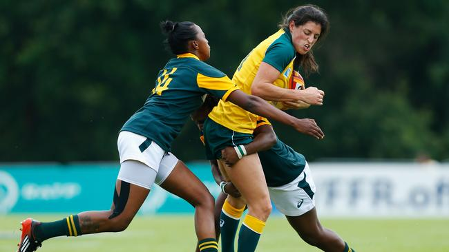 Natasha Haines is tackled by the South Africa defence.