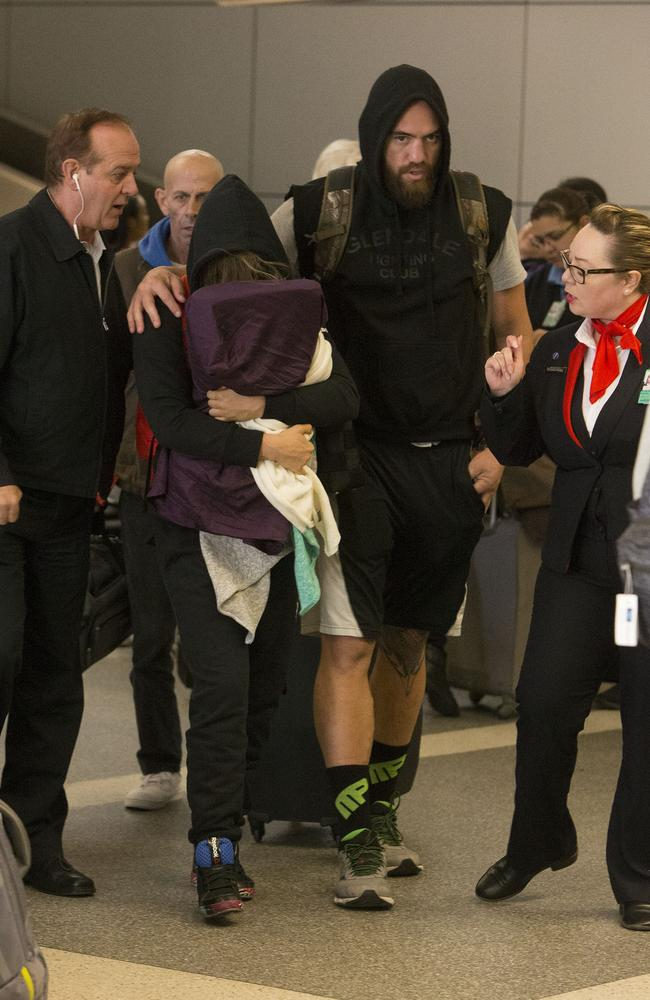 Travis Browne protests his girl Ronda Rousey at LAX after her defeat in Australia. Picture: Splash News.