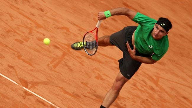 Marinko Matosevic of Australia serves in his loss to David Ferrer of Spain during day one of the French Open at Roland Garros. Picture: Matthew Stockman