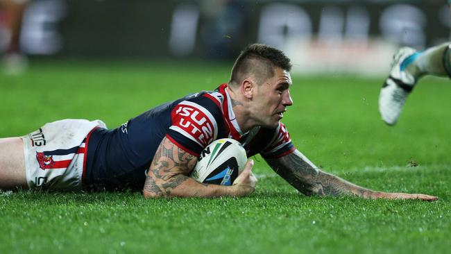 Rooster's centre Shaun Kenny-Dowall slides over for a try.