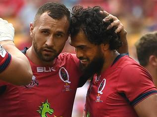 Karmichael Hunt of the Queensland Reds (right) is congratulated by teammate Quade Cooper after scoring try during their round 8 Super Rugby game against the Southern Kings at Suncorp Stadium in Brisbane, Saturday, April 15, 2017. (AAP Image/Dan Peled) NO ARCHIVING, EDITORIAL USE ONLY