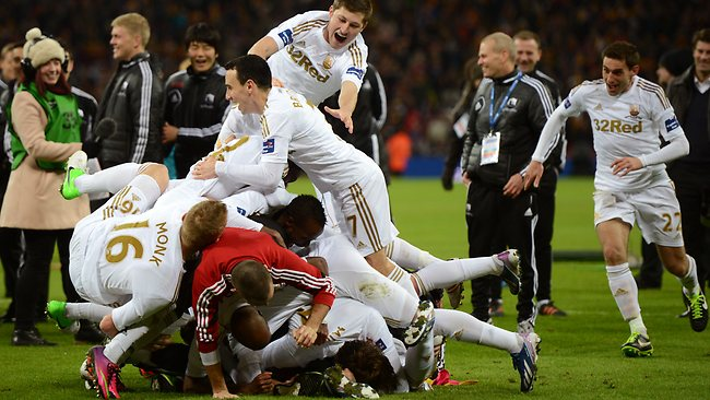 Swansea players celebrate their 5-0 victory in the League Cup final against Bradford City at Wembley Stadium. Picture: Michael Regan