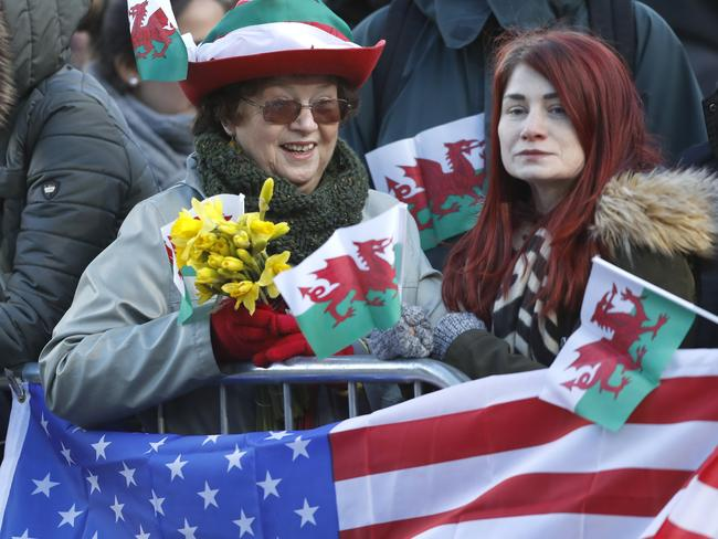 Royal fans waved American and Welsh flags. Picture: AP/Frank Augstein