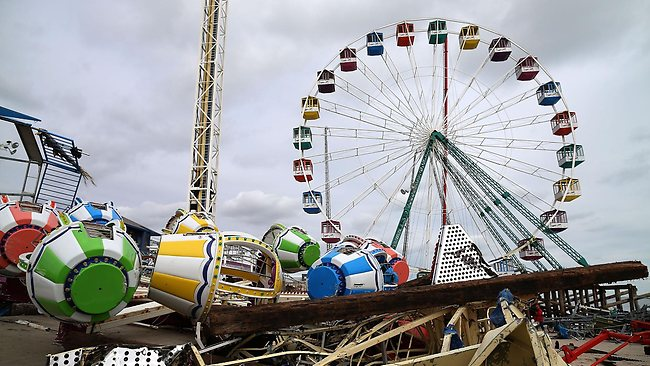 Jersey Shore smashed: amusement rides lie mangled after the Fun Town pier they sat on was destroyed by Superstorm Sandy.