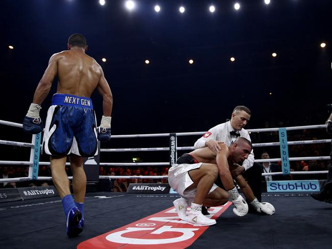 Avni Yildirim (right) is knocked down by Chris Eubank Jr. (Photo by Adam Pretty/Bongarts/Getty Images)