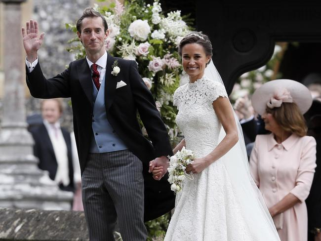 Pippa Middleton and James Matthews smile for the cameras after their wedding at St Mark's Church in Englefield. Picture: AP