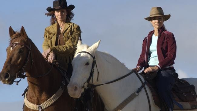 "Actor Simmone Jade Mackinnon and Bridie Carter on horseback from TV program ""McLeod's Daughters""."