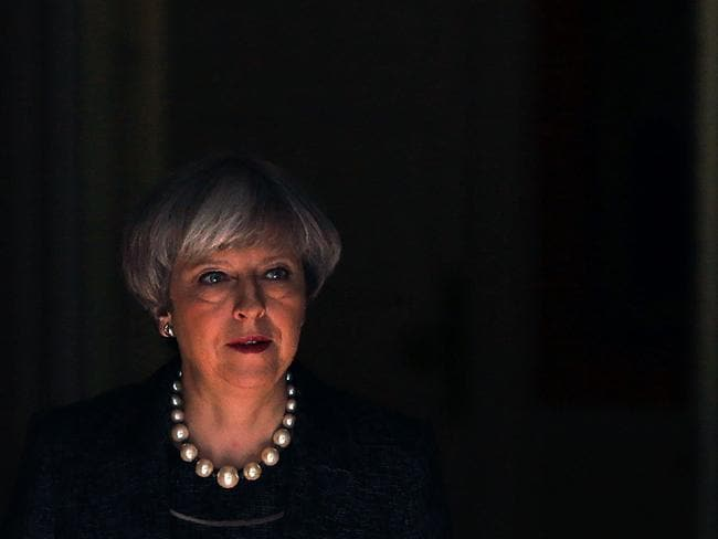 "Britain's Prime Minister Theresa May leaves 10 Downing Street in central London today. Speaking ahead of her departure for a NATO summit in Brussels, May said she would ""make clear to President (Donald) Trump that intelligence which is shared between our law enforcement agencies must remain secure"". Picture: AFP / Daniel LEAL-OLIVAS"