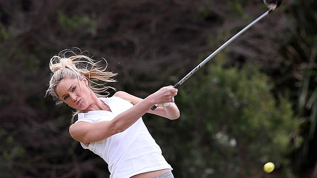 Storm hits an impressive drive down the middle of the fairway. Photo: Splash News