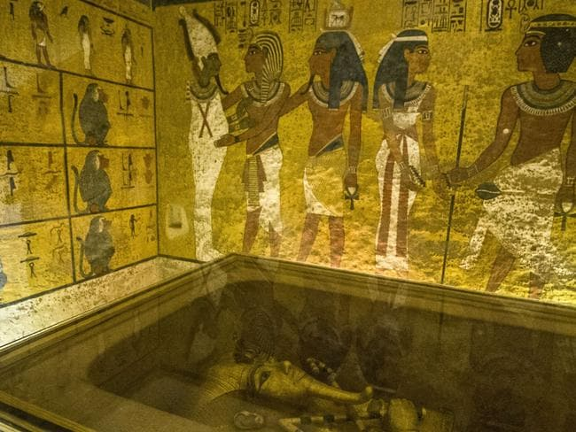Mixed messages ... The golden sarcophagus of King Tutankhamun displayed in his burial chamber in the Valley of the Kings. The wall paintings may conceal evidence of Nefertiti's burial. Source: AFP