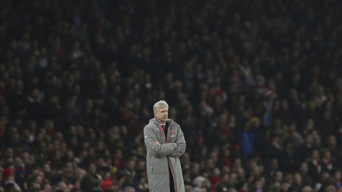 Arsenal manager Arsene Wenger looks across the pitch during the English Premier League soccer match between Arsenal and Stoke City at the Emirates stadium in London, Saturday Dec. 10, 2016. (AP Photo/Tim Ireland)