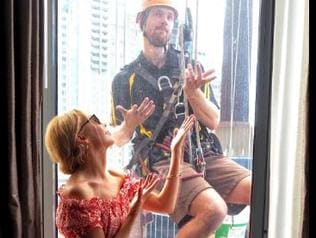 Kylie Minogue is a good sport as a window cleaner pops by hotel window. Picture: Twitter