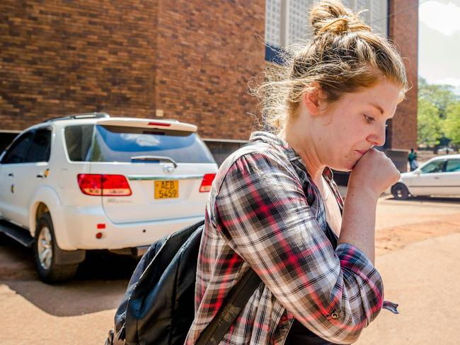 Martha O'Donovan, who was arrested for undermining the authority of Zimbabwe President Robert Mugabe on Twitter, arrives at Harare Magistrate's Court in Harare. Picture: AFP / Jekesai Njikizana