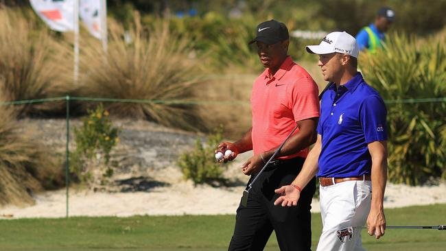Justin Thomas of the United States and Tiger Woods of the United States walk during the final round.
