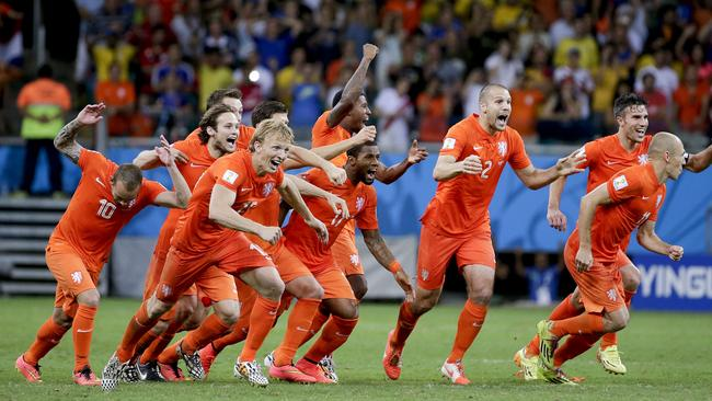 The Dutch team celebrate after winning a penalty shoot out during the World Cup quarterfinal.