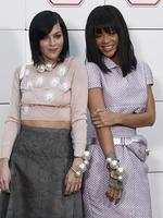 PARIS FASHION WEEK 2014: Singer Rihanna, right, and Leigh Lezark pose as they arrive to the Chanel show. Picture: AP
