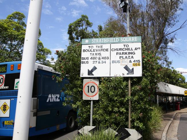 Bus signs in Strathfield Square are hopelessly out of date, confusing commuters. Picture: Craig Wilson