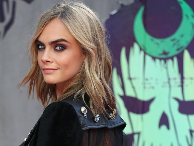 Cara Delevingne said she was relieved to see a female assistant in the room, only to have to avoid her sexual advances in front of Harvey Weinstein. Picture: AFP PHOTO / JUSTIN TALLIS