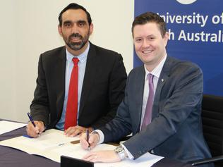 Supplied Editorial Business: Adam Goodes with UniSA Vice Chancellor, Professor David Lloyd. (Supplied)
