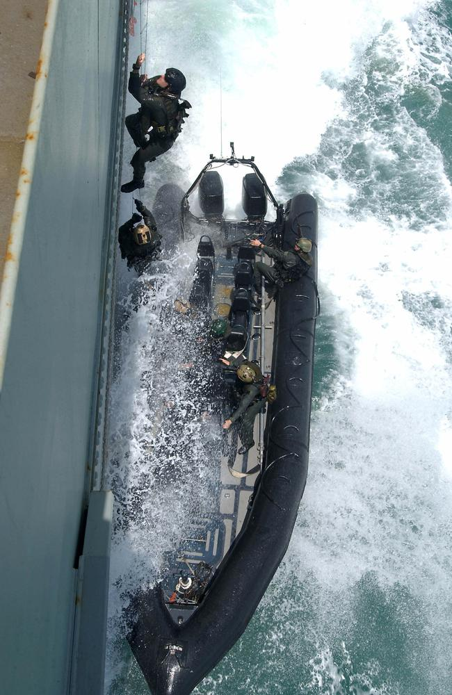 Risky business ... Australian Army Special Air Service Regiment (SASR) soldiers scale a ladder up the side of HMAS KANIMBLA during exercises as part of the National Counter-Terrorism Committee's multi- jurisdictional counter terrorism exercise (MJEX) in 2004. Source: Defence