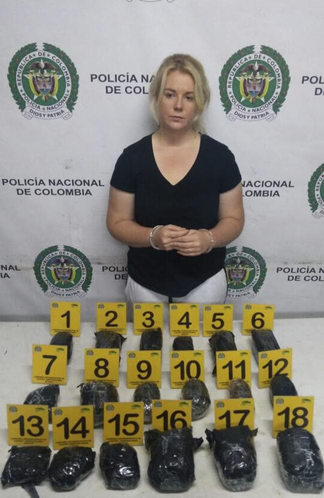Australian Cassandra Sainsbury in handcuffs after she was arrested at the international airport in Bogota, Colombia. Picture: Colombia's National Police via AP