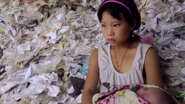 Yi-Jie, 11, dreams of leaving the plastic behind and attending school.