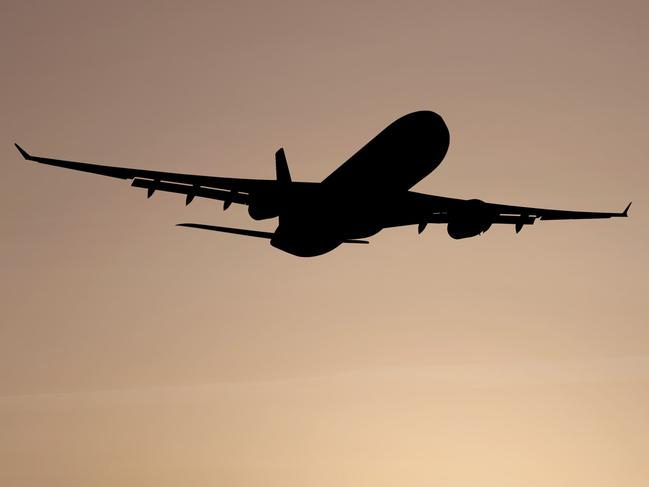 istock . airliner silhouette taking off at dusk, vertical frame. For Billy Rule. Insight.