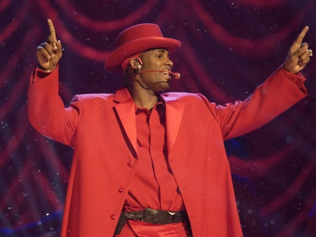 R&B singer R Kelly performs during Billboard Music Awards in 2003.