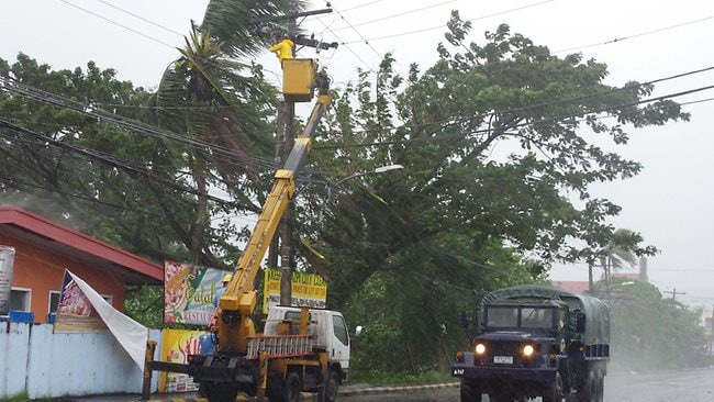 Typhoon Haiyan knocked out power and cut communications in the Philippines' central region of island provinces. Picture: AP Photo/Nelson Salting