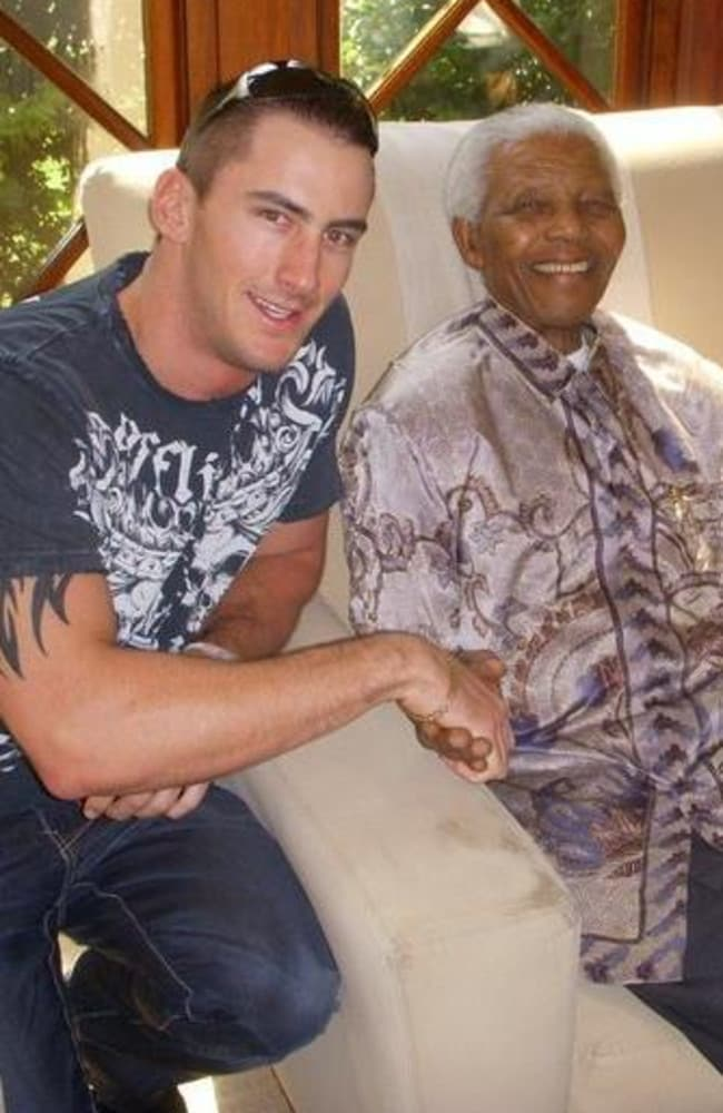 Claims ... Jared Mortimer, who says Oscar Pistorius started the alleged fight, posted this image of himself with the late Nelson Mandela on Facebook.