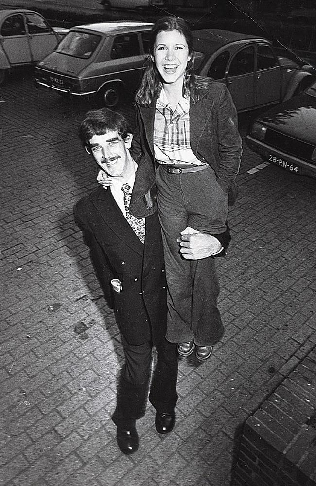 Carrie Fisher on the shoulders of Peter Mayhew who plays Chewbacca. Photo from invaluable.com from Carrie Fisher's personal collection