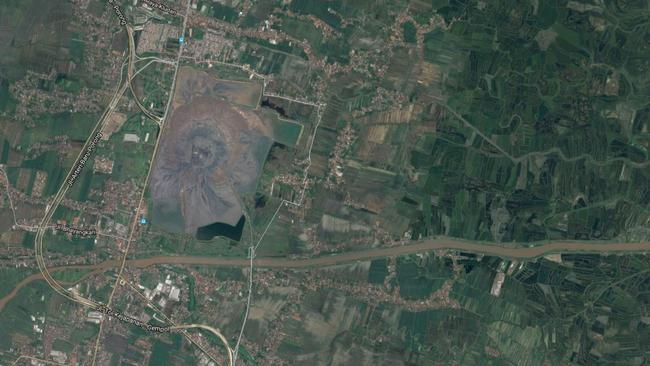 In a Google satellite image the mud volcano in Sidoarjo can easily be seen. The curving highway used to go straight though where the mud is now.
