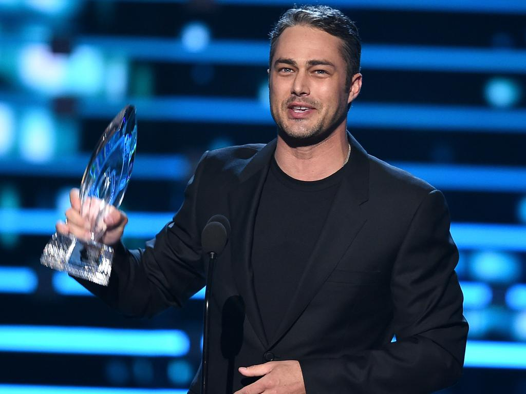 Lady Gaga's hunky fiance Taylor Kinney accepts Favorite Dramatic TV Actor award onstage during the People's Choice Awards. Picture: Getty