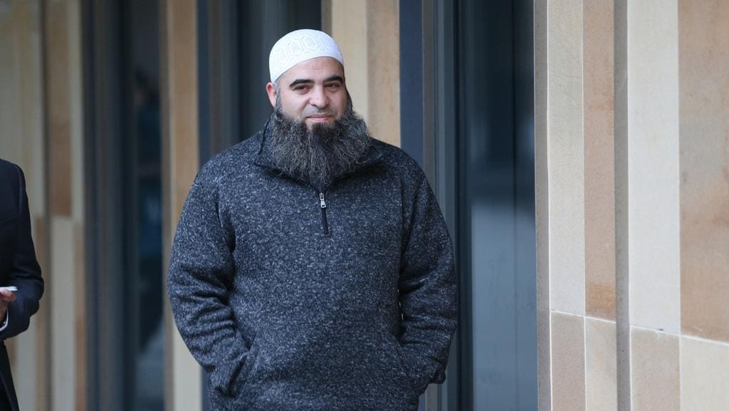 Hamdi Alqudsi, from St Helen's Park, pleaded not guilty to seven counts of ­recruiting men and assisting them with the intention of facilitating their entry into Syria for hostile activity between June and November, 2013. Leaving court in Parramatta.