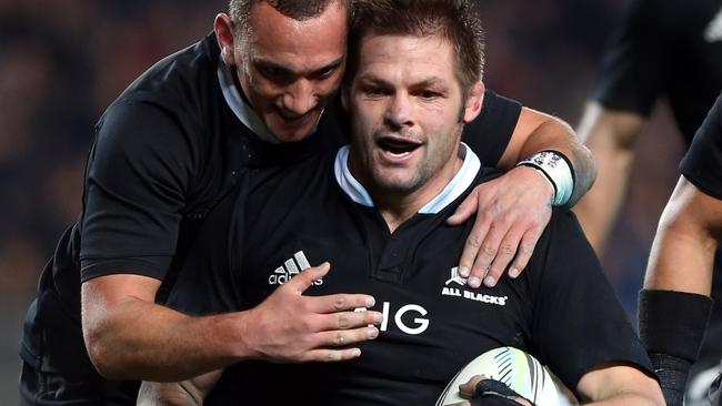 Richie McCaw celebrates one of his tries against the Wallabies with All Blacks teammate Aaron Cruden.