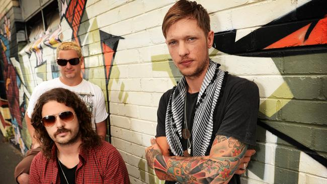 John's boy ... Rival Fire, fronted by the heavily tattooed Rob Farnham, are ready to Riot.
