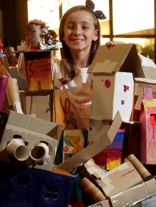 Clementine Struthers, the girl who came up with the DreamBIG name, with student art for the festival.