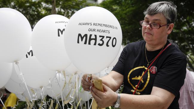 Widow Jacquita Gomes prepares balloons with names of those who died, including her husband Patrick Gomes.Picture: AP/Joshua Paul